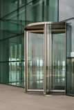 Revolving glass door. On a modern corporate building Royalty Free Stock Photography