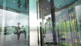 Revolving glass door stock footage