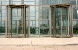 Revolving glass doors. On a modern corporate building Stock Photo