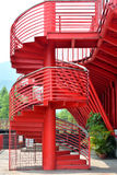Revolving ladder with handrail in red. Revolving ladder with metal handrail in red, shown as composition by shape and line with rhythm, and architecture pattern Stock Images