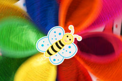 Revolving windmill. A revolving windmill with a smiling bee Stock Photo