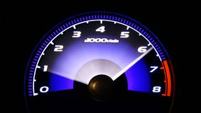 Revving engine. Tachometer revs and exceeds 6000 rmp Royalty Free Stock Image