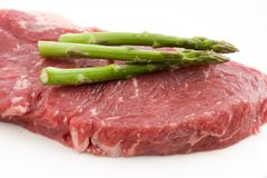 Rew beef and asparagus Royalty Free Stock Photo