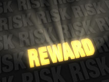 The Reward Beats The Risk. Brilliant light rays burst from a glowing, gold REWARD on a dark background of RISK Royalty Free Stock Photos