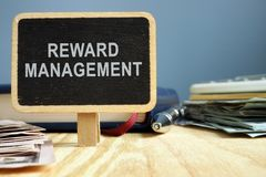 Reward management. Office table with note pad. royalty free stock photos