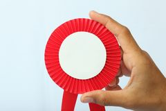 Reward red sign in hand Royalty Free Stock Photo