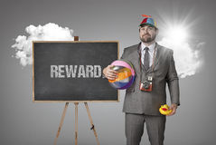 Reward text with holiday gear businessman Royalty Free Stock Image