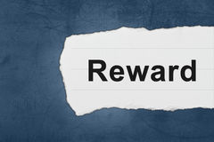 Reward with white paper tears. On blue texture Stock Photography
