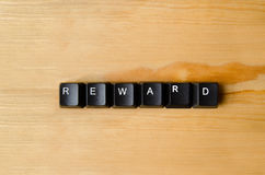 Reward word. With keyboard buttons Stock Photos