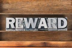 Reward word tray. Reward word made from metallic letterpress type on wooden tray Stock Photos
