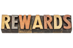 Rewards word in letterpress wood type Royalty Free Stock Photo
