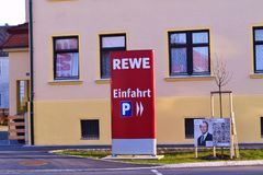 Rewe. Name of the famous chain of hypermarkets in Germany Royalty Free Stock Image