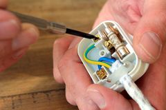 Rewiring a UK 13 amp domestic electric plug.  stock images