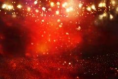 Rewolucjonistka, czerń i złocisty błyskotliwość świateł tło, defocused fotografia stock