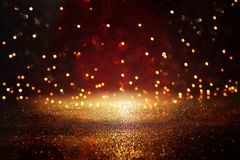 Rewolucjonistka, czerń i złocisty błyskotliwość rocznika świateł tło, defocused zdjęcie stock