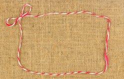 Rewolucjonistki i bielu łęku arkany rama na brown konopie Fotografia Royalty Free