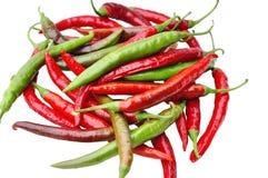 Rewolucjonistki i zieleni chili pieprze na biały tle Obraz Royalty Free
