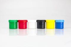 Rewolucjonistki i zieleni farby pudełka z muśnięciami Obraz Royalty Free