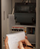 Rewriting of the electrical meter readings. At home in Russia. Close up shot Stock Photos