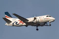 REX Airlines Saab exprès régional 340B VH-ZLO à l'approche à la terre à l'aéroport international de Melbourne Images libres de droits