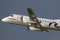 REX Airlines Saab exprès régional 340B VH-ZRC décollant de l'aéroport international de Melbourne Photo stock