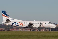 REX Regional Express Airlines Saab 340 twin engined regional commuter aircraft at Sydney Airport. Royalty Free Stock Images