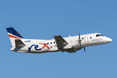 REX Regional Express Airlines Saab 340 twin engined regional commuter aircraft taking off from Sydney Airport. Stock Image