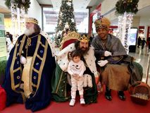 Reyes magos, three wise men. MADRID, SPAIN - DECEMBER 28: Reyes Magos. Three wise men with a little girl posing for picture in a shopping centre in December 28 Stock Image