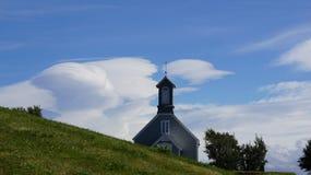 Reykholt kyrka i molnen Fotografering för Bildbyråer