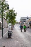 Austurstraeti street in Reykjavik city in autumn. REYKJAVIC, ICELAND - SEPTEMBER 6, 2017: people walk on Austurstraeti street in Reykjavik downtown in autumn Royalty Free Stock Image