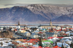 Reykjavik city. Aerial view of Reykjavik city with sea and Esja volcanic mountain range in background, Iceland