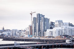 Reykjavik city with tall buildings and a crane at a construction Royalty Free Stock Photos