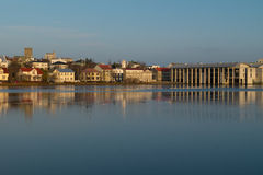 Reykjavik Cityhall. Skyline of Reykjavik with the Cityhall at Tjörnin Lake with reflections Royalty Free Stock Image