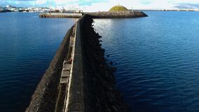 Reykjavik harbor and a harborwall to protect the ships.