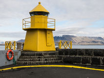 Reykjavik harbor yellow lighthouse Royalty Free Stock Photography