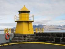 Reykjavik harbor yellow lighthouse Royalty Free Stock Image