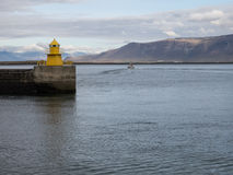 Reykjavik harbor yellow lighthouse Stock Photo