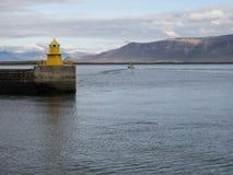 Reykjavik harbor yellow lighthouse Stock Photo