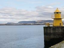 Reykjavik harbor yellow lighthouse Stock Images