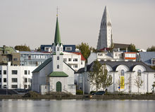 Reykjavik in Iceland. Part of Reykjavik in Iceland with a traditional wooden church in the foreground the modern Hallgrimskirkja Church in the background Royalty Free Stock Photography