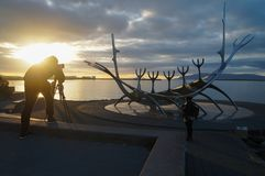 Unidentified tourist taking picture of Sun Voyager,Iceland. Royalty Free Stock Image