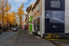 REYKJAVIK, ICELAND - OCTOBER 15, 2014: Street in Reykjavik, Iceland. Late Autumn CItyscape with Tree. Royalty Free Stock Image