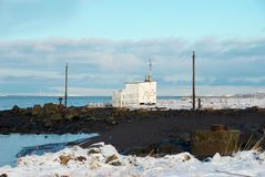Reykjavik's beach. A white shed with snow on Reykjavik's beach, Iceland royalty free stock photography