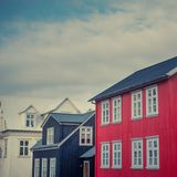 Traditional Corrugated Iron Clad Houses on a Street in Reykjavik. Reykjavik Street With Colorful Iron Clad Houses Royalty Free Stock Images