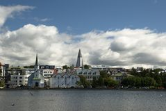 Reykjavik viewed from Tjornin lake. Reykjavik, capitol of Iceland, on clear summer day, viewed from Tjornin lake Royalty Free Stock Photos