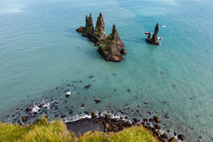 Reynisdrangar cliffs in the ocean, South Iceland Stock Photography