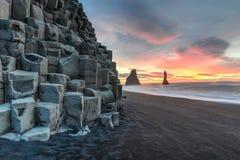 Reynisdrangar on Reynisfjara Beach. Wide view of Reynisdrangar rock formations on Reynisfjara Beach at sunrise, Halsanefhellir, Iceland Royalty Free Stock Images