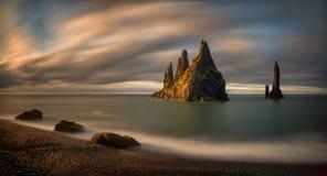 Reynisdrangar rocks sunrise. Reynisfjara Beach with group of rocks at sunrise, Iceland stock image
