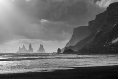 Reynisfjara Black Sand Beach. And Reynisdrangar basalt sea stacks as seen near Vik, Iceland Stock Images