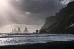 Reynisfjara Black Sand Beach. And Reynisdrangar basalt sea stacks as seen near Vik, Iceland Stock Image
